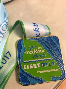 "I don't think I've ever used the word ""pretty"" to describe a race medal but this one is."